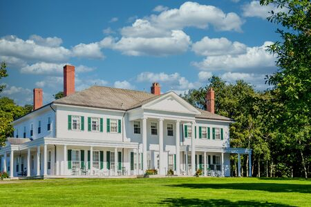 White Columned House on Green Lawn