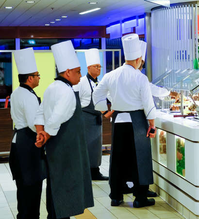 Chefs Inspecting Buffet on Ship