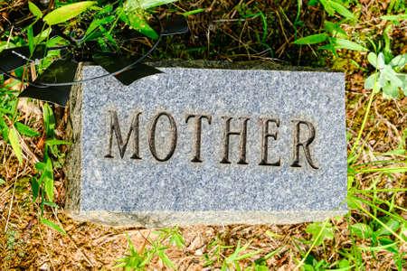 Mother on Granite Grave Marker Фото со стока