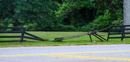 Broken Fence by Roadside