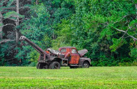 Old Rusty Wrecker in Field