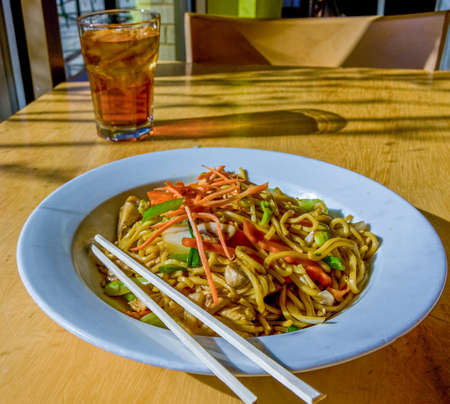 Noodle Dish and Iced Tea