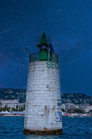 Concrete channel marker under starry sky Фото со стока