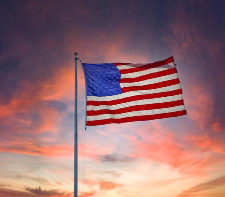 Bright Backlit Flag by Sunset Фото со стока