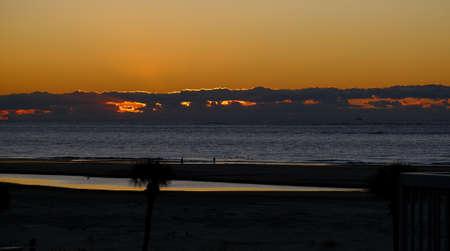 Sun Breaking Through Cloud Cover Фото со стока