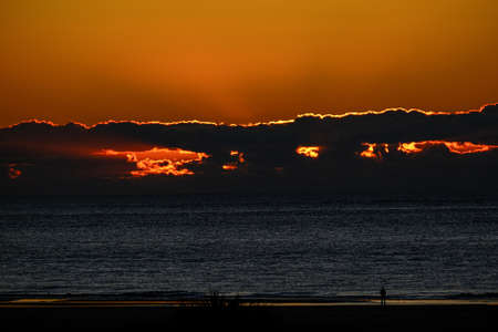 Stormy Sunrise Over Beach