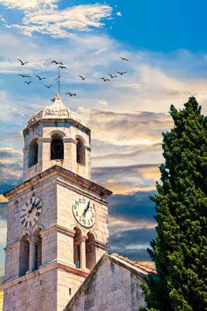 Old Clock Tower by Tree Фото со стока
