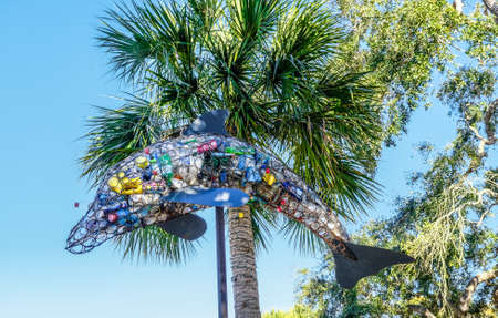 Recycled Cans and Bottles in Dolphin Basket