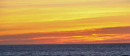 Bands of Orange and Yellow Sunrise Фото со стока
