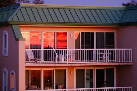 Reflection of Sunrise in Glass Фото со стока