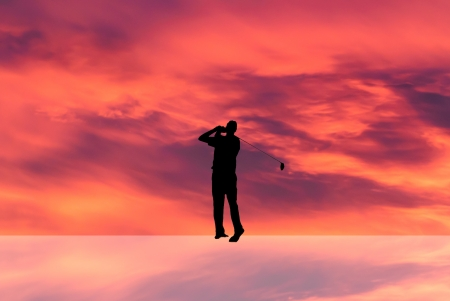 follow through: silhouette golfer in a red sky Stock Photo