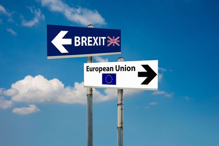 eu: a road signs EU and BREXIT and a blue sky Stock Photo