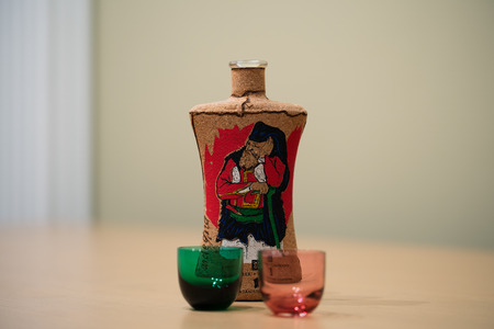 liqueurs: an italian liqueur and two colored glasses