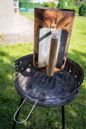 Grill garden party with sausages and meat on hot briquettes in Czech Republic, Liberec region Stock Photo
