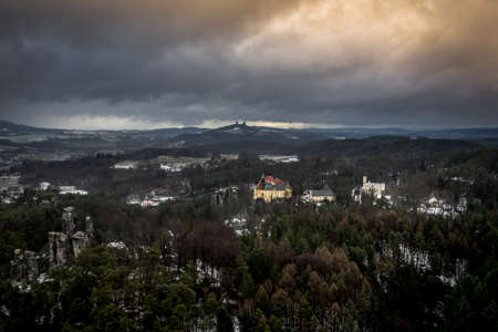 Hruba Skala is located next to the sandstone 'rock town', stretching to Trosky Castle. 写真素材 - 124660028
