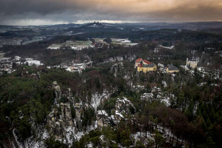 Hruba Skala is located next to the sandstone 'rock town', stretching to Trosky Castle. 写真素材 - 124660029