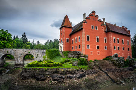 Cervena Lhota Chateau. It stands at the middle of a lake on a rocky island. Its picturesque Renaissance is a destination of thousands of tourists every year. Stok Fotoğraf - 124660624