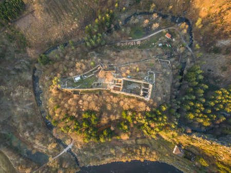 Divci kamen is a ruin of Gothic castle near the town Kremze in Cesky Krumlov district. It stands at an altitude of 470 m on a rocky hill surrounded by three sides near the Vltava river. Reklamní fotografie