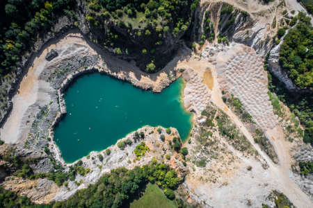 The quarry was opened in 1918 and over the course of the 20th century it gradually expanded its area by merging with the surrounding smaller quarries. Bathing is prohibited in the flooded area.