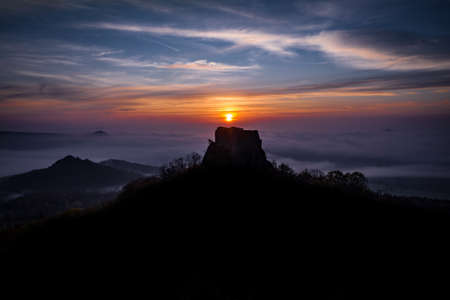 Oltarik is a castle ruin on the hill of the same name in the Ceske stredohori Mountains. It rises above the village of Dekovka in the southwest of Lovosice in the district of Litomerice Фото со стока