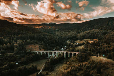 The railway viaduct was built near the village of Novina on the line from Liberec to Ceska Lipa between 1898 and 1900. The viaduct, which has 14 arches, is 230 meters long and approximately 29 meters.