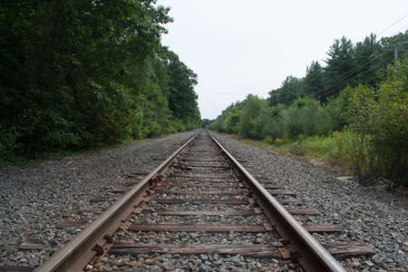 A set of train tracks rolls off into the distance