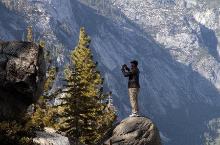 YOSEMITE VALLEY; May 30 2011, a Park visitor takes a snapshot of Yosemite Valley.