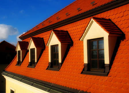 dormer: old building with red roof Stock Photo