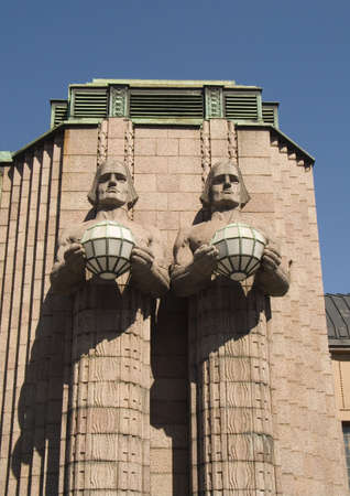 monumental: Helsinki Station with Monumental Statues Stock Photo