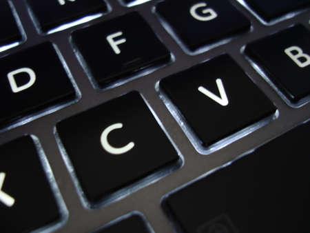 backlit keyboard: CV Resume keyboard Stock Photo