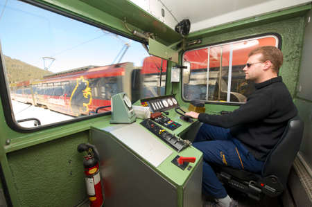 Circa Montreux, Switzerland, December 09, 2009 - Driver of the Golden pass train drives locomotive. The Golden Pass line is a major tourist attraction in Switzerland. Editöryel