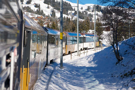Circa Montreux, Switzerland - December 09, 2009 - Golden pass train in Swiss Alps connects Montreux to Lucerne. Ride in panoramic train is one of the major tourist attraction in Switzerland.