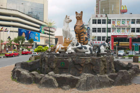 borneo: Kuching, Malaysia - August 26, 2009: Cats monument at the downtown in Kuching, Malaysia. Due to abundance of cats in the area Kuching is often called  \The cats city\.