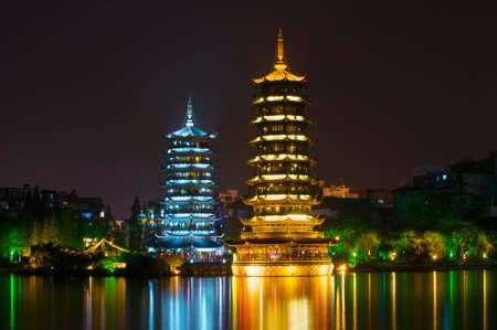 Sun and Moon pagodas at Banyan Lake, Guilin, Guangxi, China photo