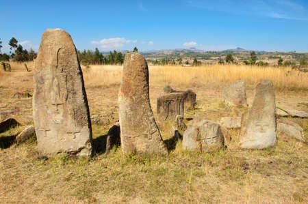 Mysterious megalithic Tiya stone pillars, UNESCO World Heritage Site, Ethiopia. Reklamní fotografie - 34677437