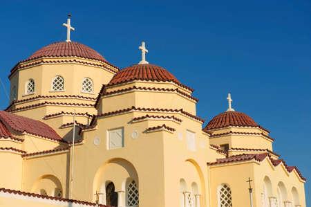 Orthodox church domes in Kamari, Santorini island, Greece.