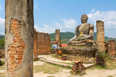 relict: Relics of Wat Piyawat temple, Xiangkhouang province, Laos. This Buddha image is the only one in Phonsavan area, which survived US carpet bombings of Laos during Vietnam war.