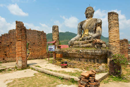 bombings: Relics of Wat Piyawat temple, Xiangkhouang province, Laos. This Buddha image is the only one in Phonsavan area, which survived US carpet bombings of Laos during Vietnam war.