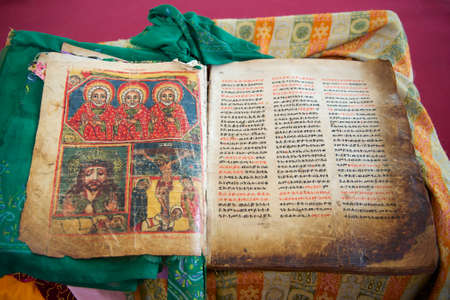 Ancient Bible in Amharic language in the church of Our Lady Mary of Zion, the most sacred place for all Orthodox Ethiopians. Aksum, Ethiopia. Stock Photo