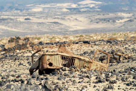 aden: Aden, Yemen - September 14, 2006 : Remains of a cabin of a Soviet truck GAZ-66 at the former mine field near Aden, Yemen. Editorial