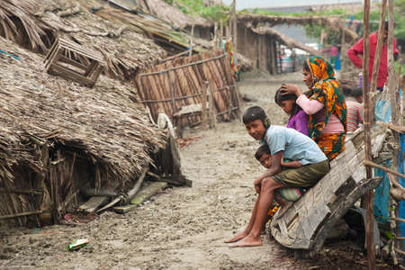Mongla, Bangladesh, February 17, 2014 - Woman takes care of her kids in Mongla, Bangladesh. Editöryel