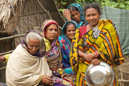 Mongla, Bangladesh, February 17, 2014 - Women wait for their husbands from fishing in Mongla, Bangladesh.