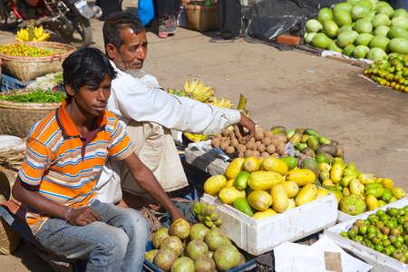 Bandarban, Bangladesh, February 20, 2014 - Men sell fruits at the local market in Bandarban, Bangladesh.