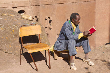 Lalibela, Ethiopia, January 27, 2010 - Man reads book in Lalibela, Ethiopia. Ethiopia has one of the highest levels of illiteracy in the world.