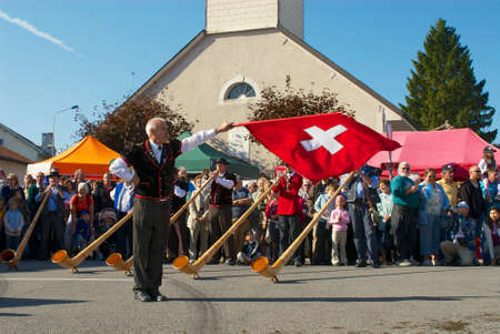 resonate: Affoltern Im Emmental, Switzerland, September 22, 2007 - Man performs traditional flag twirling at the annual Cheese Festival in Affoltern Im Emmental, Switzerland.