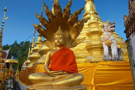 Buddha statue in red at Wat Boromthat, Tak, Thailand. photo