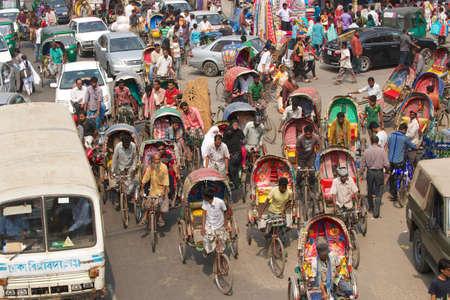 nicknamed: Dhaka, Bangladesh, February 22, 2014 - Rickshaws transport passengers in Dhaka, Bangladesh. About 500 000 rickshaws daily cycle in Dhaka,  nicknamed \\\the rickshaws capital of the world\\\.