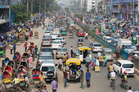overpopulated: Dhaka, Bangladesh, February 22, 2014 - Busy traffic at the central part of the city in Dhaka, Bangladesh. Dhaka is one of the most overpopulated cities in the world.