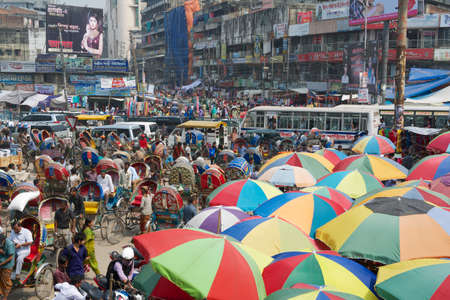 dhaka: Dhaka, Bangladesh, February 22, 2014 - People go to shopping at the Old market in Dhaka, Bangladesh. Dhaka is one of the most overpopulated cities in the world.