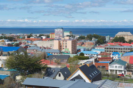 arenas: Punta Arenas, Chile - October 28, 2013 : Scenic view of Punta Arenas and Magellan straitin Punta Arenas, Chile. It is the southernmost city on the planet with population over 100 thousand located on continent. Editorial